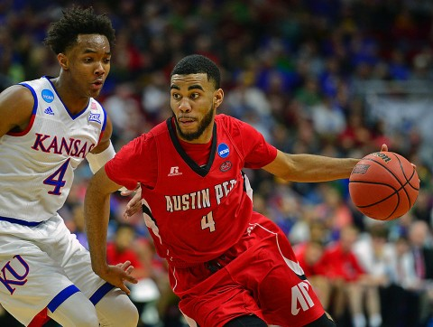 Austin Peay Governors guard Josh Robinson (4) drives to the basket against Kansas Jayhawks guard Devonte' Graham (4) during the first half in the first round of the 2016 NCAA Tournament at Wells Fargo Arena. (Jeffrey Becker-USA TODAY Sports)