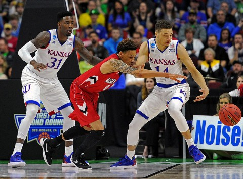 Austin Peay Governors guard Khalil Davis (11) goes for a loose ball against Kansas Jayhawks guard Brannen Greene (14) and forward Jamari Traylor (31) during the first half in the first round of the 2016 NCAA Tournament at Wells Fargo Arena. (Steven Branscombe-USA TODAY Sports)