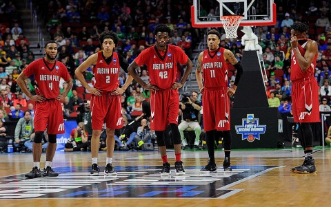The Austin Peay Governors stand at mid-court during the first half against the Kansas Jayhawks in the first round of the 2016 NCAA Tournament at Wells Fargo Arena. (Steven Branscombe-USA TODAY Sports)