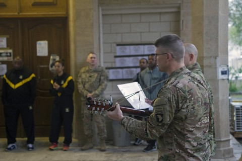 Lt. Col. David A. Bowlus, Combined Joint Force Land Component Command – Operation Inherent Resolve chaplain, plays guitar for Soldiers at an Easter sunrise service in Baghdad, Iraq, March 27, 2016. (U.S. Army photo by Sgt. Katie Eggers)