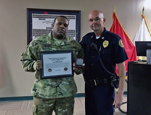 SGT Jamil Moore (left) receives a Citizen Commendation Certificate and a CPD Coin from District 1 Commander, Capt David Crockarell. (CPD)