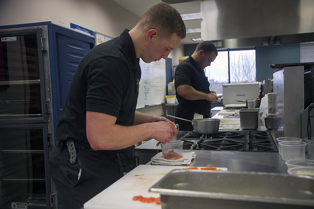 Spc. Brandon Keller, a culinary specialist, assigned to 526th Brigade Support Battalion, 2nd Brigade Combat Team, 101st Airborne Division (Air Assault), prepares a meal at the culinary lab at the education center on Fort Campbell, Ky., Feb. 25, 2016. Keller is part of the Fort Campbell Culinary Team will compete in the 41st Military Culinary Arts Competitive Training Event at Fort Lee, Va., March 3-11. (Staff Sgt. Terrance D. Rhodes, 2nd Brigade Combat Team, 101st Airborne Division (Air Assault) Public Affairs)