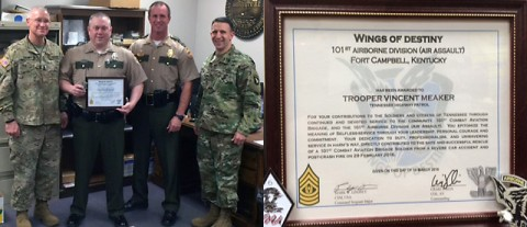 Tennessee Highway Patrol Trooper Vincent Meaker is presented the Wings of Destiny 101st Airborne certificate of appreciation for selfless-service.