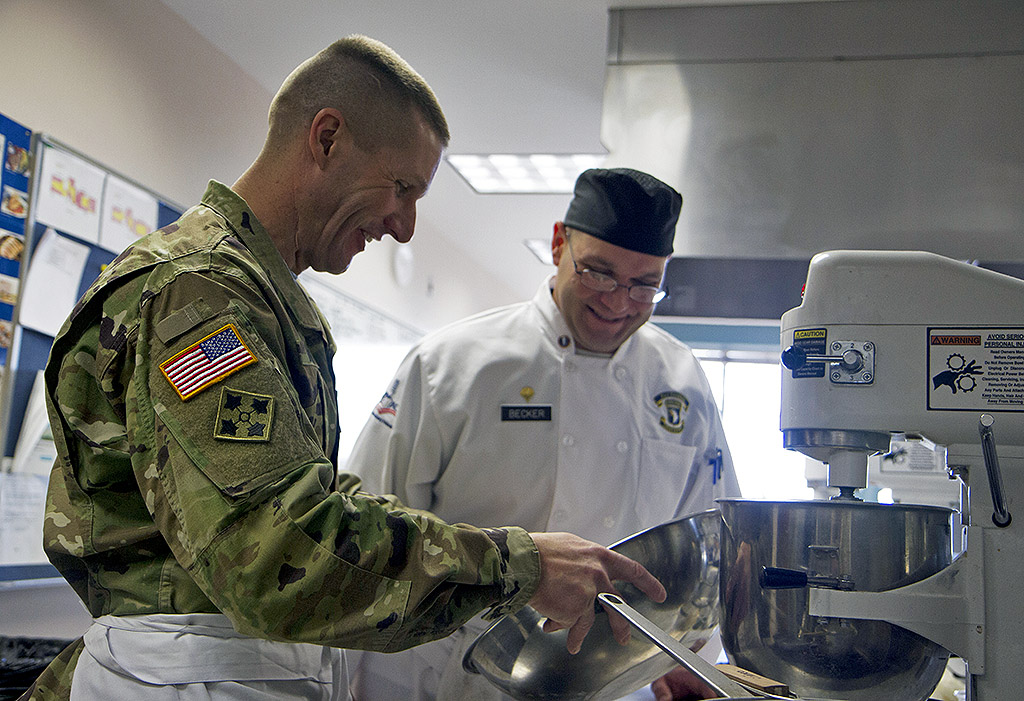 Sgt. Maj. of the Army Daniel A. Dailey prepares a meal with Spc. Gregory Becker, a food service specialist with 21st Brigade Engineer Battalion, 3rd Brigade Combat Team, 101st Airborne Division (Air Assault), at the Austin Peay State University culinary arts center, Fort Campbell, KY. Becker is currently competing for the second time in the Military Culinary Arts Competitive Training Event held at Fort Lee, VA. (Sgt. William White, 101st Airborne Division Public Affairs)