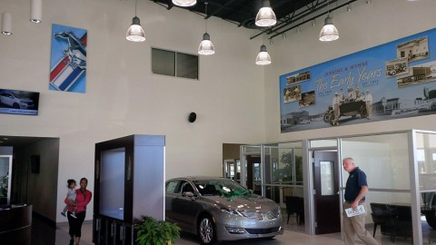 Oversize color panels and murals in the Ford-Lincoln showroom celebrate historic autos, as well as Jenkins & Wynne's history through the decades.