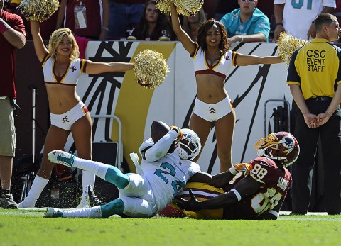 Miami Dolphins defensive back Brice McCain (24) intercepts a pass over Washington Redskins wide receiver Pierre Garcon (88) during the second half at FedEx Field on September 13th 2015. (Brad Mills-USA TODAY Sports)