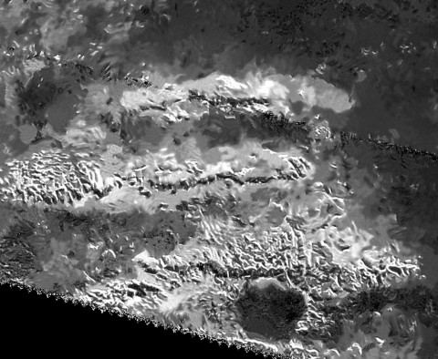 The trio of ridges on Titan known as Mithrim Montes is home to the hazy Saturnian moon's tallest peak. (NASA/JPL-Caltech/ASI)