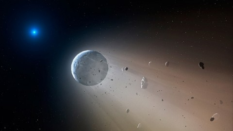In this artist's conception, a tiny rocky object vaporizes as it orbits a white dwarf star. Astronomers have detected the first planetary object transiting a white dwarf using data from the K2 mission. Slowly the object will disintegrate, leaving a dusting of metals on the surface of the star. (CfA/Mark A. Garlick)