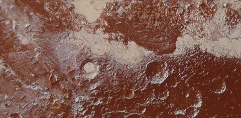 This enhanced color view of Pluto's surface diversity was created by merging Ralph/Multispectral Visible Imaging Camera (MVIC) color imagery (650 meters or 2,132 feet per pixel) with Long Range Reconnaissance Imager panchromatic imagery (230 meters or 755 feet per pixel). At lower right, ancient, heavily cratered terrain is coated with dark, reddish tholins. At upper right, volatile ices filling the informally named Sputnik Planum have modified the surface, creating a chaos-like array of blocky mountains. Volatile ice also occupies a few nearby deep craters, and in some areas the volatile ice is pocked with arrays of small sublimation pits. (NASA/JHUAPL/SwRI)