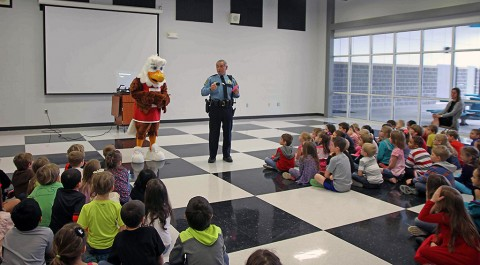 School Resource Officer Jim Knoll assisted Eddie in teaching a class on gun safety to children at Carmel Elementary School.