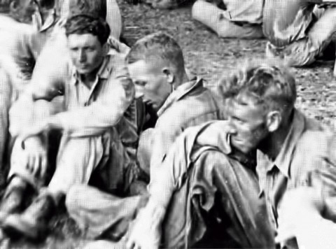 (L to R) Preston J. Hubbard, age at the time: 23, Paul G. Inzer, age at the time: 16, and a soldier not identified. This picture is of a rest stop, on the Death March, in Balanga, Bataan.