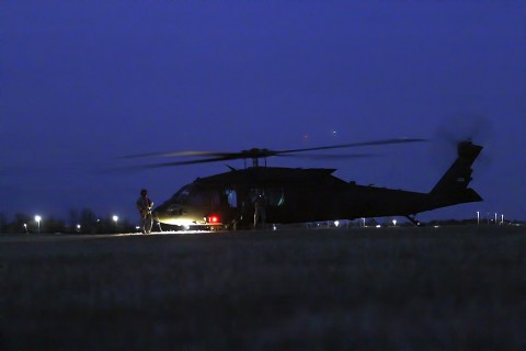 "Crew chiefs with Alpha Company, 2nd Battalion (Assault), 10th Aviation Brigade, 10th Mountain Division, wait for Soldiers to begin loading onto the UH-60 Black Hawk during the night air assault Feb. 28, 2016, on Fort Campbell, Ky. The ""Voodoo"" crew chiefs assisted 1st Battalion, 506th Infantry Regiment, 1st Brigade Combat Team, 101st Airborne Division (Air Assault) during the battalion air assault, a mission conducted during the brigade's field exercise. (Sgt. Samantha Stoffregen, 1st Brigade Combat Team, 101st Airborne Division (Air Assault) Public Affairs)"