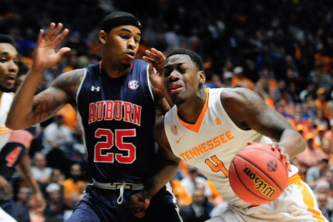 Tennessee Volunteers forward Armani Moore (4) keeps the ball away from Auburn Tigers forward Jordon Granger (25) during game one of the SEC Tournament at Bridgestone Arena. (Joshua Lindsey-USA TODAY Sports)