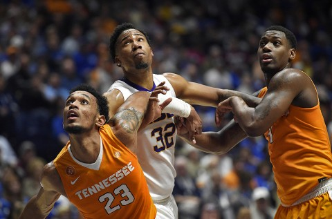 LSU Tigers forward Craig Victor II (32) battles for positioning with Tennessee Volunteers forward Derek Reese (23) and forward Armani Moore (4) in fie first half during the SEC tournament at Bridgestone Arena. (Christopher Hanewinckel-USA TODAY Sports)