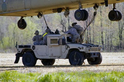 A sling load team from 227th Quartermaster Company, 129th Combat Sustainment Support Battalion, 101st Airborne Division Sustainment Brigade, 101st Airborne Division (Air Assault), attach a Humvee to a Ch-47 Chinook helicopter April 12, 2016, at Fort Campbell, Ky. (U.S. Army Sgt. Neysa Canfield, 101st Sustainment Brigade Public Affairs)
