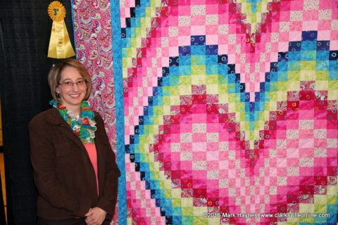 "Dana Fucella with her quilt ""Heart Bargello"" that won third place in the Non-Traditional Bed Quilt category at Quilts of the Cumberland."
