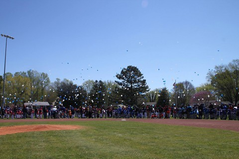 Clarksville Nationals Little League teams released balloons in honor of Detective Tyler Barrett.