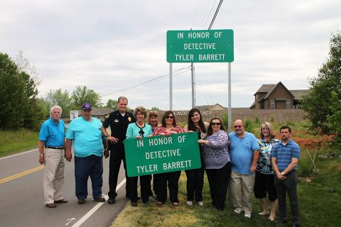 Clarksville Mayor Kim McMillan, the Clarksville City Council, CPD Chief Al Ansley, CPD personnel, the Clarksville Streets Department, and Tyler Barrett's family and friends at sign unveiling.