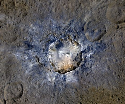 Ceres' Haulani Crater, with a diameter of 21 miles (34 kilometers), shows evidence of landslides from its crater rim. (NASA/JPL-Caltech/UCLA/MPS/DLR/IDA)
