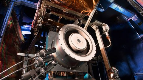 Advanced solar electric propulsion will be needed for future human expeditions into deep space, including to Mars. Shown here is a 13-kilowatt Hall thruster being evaluated at NASA's Glenn Research Center in Cleveland. Hall thrusters trap electrons in a magnetic field and use them to ionize the onboard propellant. It uses 10 times less propellant than equivalent chemical rockets. (NASA)