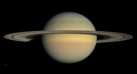 Saturn as seen by NASA's Cassini spacecraft in 2008. Long-term tracking of the spacecraft's position has revealed no unexplained perturbations in Cassini's orbit. (NASA/JPL/Space Science Institute)