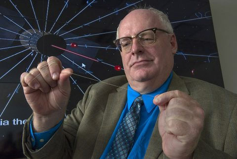 NASA engineer Bruce Wiegmann, principal investigator for the HERTS E-Sail, demonstrates the long, thin wires that will construct the E-Sail. Each tether is extremely thin, only 1 millimeter -- the width of a standard paperclip -- and very long, 12.5 miles. (NASA/MSFC/Emmett Given)