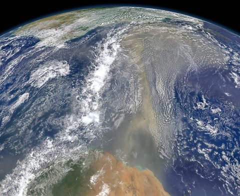 Satellites have documented that human-produced and natural air pollution can travel a long way. This 2014 NASA satellite image shows a long river of dust from western Africa (bottom of image) push across the Atlantic Ocean. (NASA)