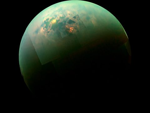 Sunlight glints off of Titan's northern seas this near-infrared, color mosaic from NASA's Cassini spacecraft. (NASA/JPL/Univ. Arizona/Univ. Idaho)