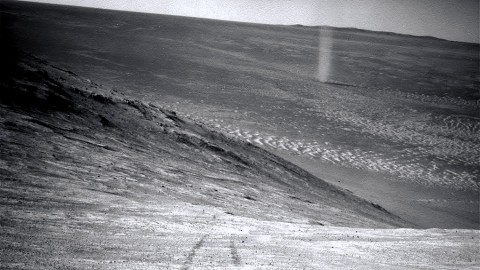 From its perch high on a ridge, NASA's Mars Exploration Rover Opportunity recorded this image of a Martian dust devil twisting through the valley below. (NASA/JPL-Caltech)
