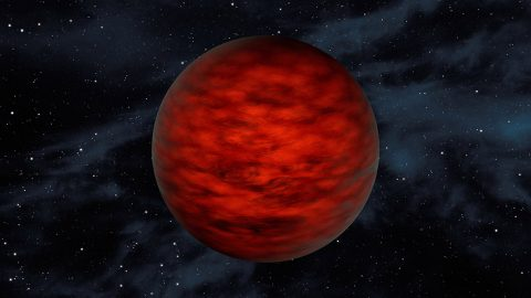 """A young, free-floating world sits alone in space in this illustration. The object, called WISEA J114724.10?204021.3, is thought to be an exceptionally low-mass """"brown dwarf,"""" which is a star that lacked enough mass to burn nuclear fuel and glow like a star. (NASA/JPL-Caltech)"""