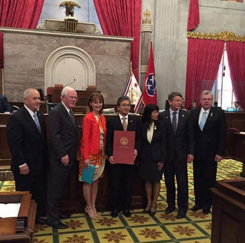 Rep. Curtis Johnson on the far right presented the House Joint Resolution to Mr. Kinefuchi (4th from left). Also, from the left is the governor's chief of state, Jim Henry; House Finance Chairman, Charles Sargent; and Speaker of the House Beth Harwell.