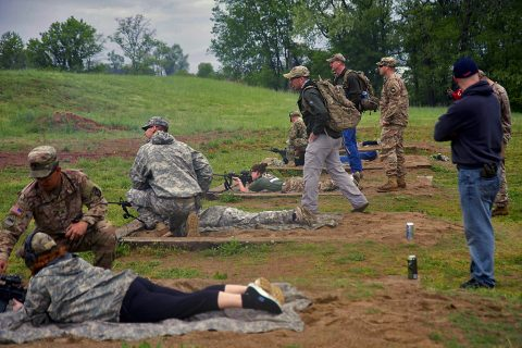 Spouses of Soldiers in 1st Battalion, 26th Infantry Regiment, 2nd Brigade Combat Team, 101st Airborne Division are coached by their husbands on M4 rifle skills here, April 21, 2016. (1st Lt. Daniel I. Johnson, 2nd Brigade Combat Team, 101st Airborne Division (Air Assault) UPAR)