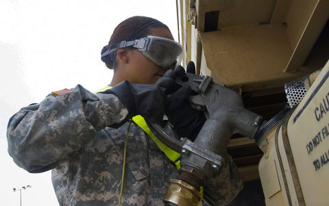 Spc. Tabitha G. Wilson, a petroleum supply specialist with 227th Quartermaster Company, 129th Combat Sustainment Support Company, 101st Sustainment Brigade, 101st Airborne Division (Air Assault), fuels a vehicle from 3rd Brigade Combat Team, 101st Abn. Div., during the Sea Emergency Deployment Readiness Exercise at Port Arthur, Tx., April 27, 2016. (Sgt. Neysa Canfield, 101st Airborne Division Sustainment Brigade Public Affairs)