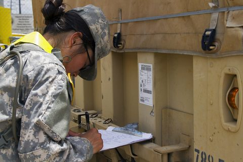 Pfc. Elle Y. Bailey, a transportation management coordinator with 613th Movement Control Team, 129th Combat Sustainment Support Battalion, 101st Sustainment Brigade, 101st Airborne Division (Air Assault), writes down the 3rd Brigade Combat Team, 101st Abn. Div.'s bumper number in order to keep accountability of the vehicles being staged at the marshaling area at Port Arthur, Tx., April 26, 2016. (Sgt. Neysa Canfield, 101st Airborne Division Sustainment Brigade Public Affairs)