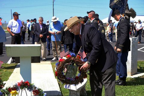 Alfred May places a wreath by the Alpha Company, 1st Battalion, 506th Infantry Regiment, 1st Brigade Combat Team, 101st Airborne Division (Air Assault) memorial to honor his fallen brothers-in-arms during his time in Vietnam on May 13, 2016. May, who attended the 1st Bn. 506th Inf Regt. Distinguished and Honorary Member of the Regiment induction ceremony, was one of the original members that helped to create the first memorial in Camp Evans, Vietnam in 1971 and the recreated memorial that stands in Fort Campbell today. (Staff Sgt. Jesse Anderla, 1st Brigade Combat Team, 101st Airborne Division (Air Assault) Public Affairs)