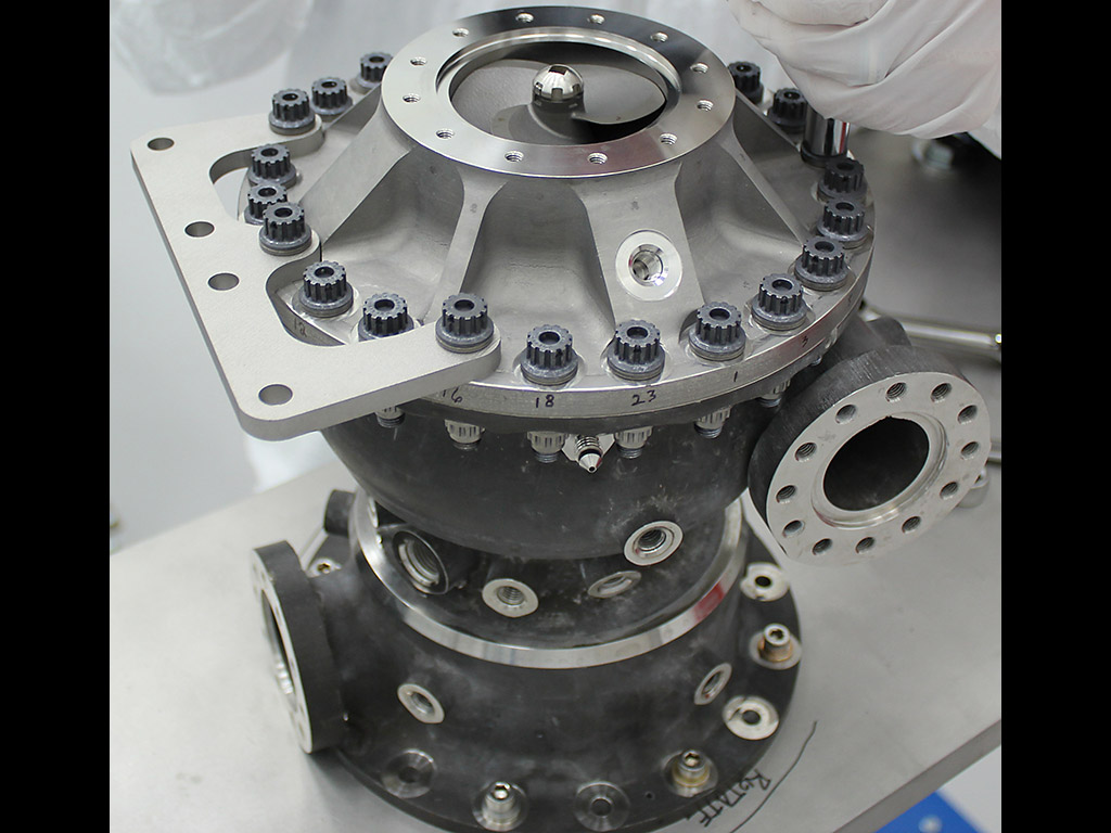 This rocket engine fuel pump has hundreds of parts including a turbine that spins at over 90,000 rpms. This turbopump was made with additive manufacturing and had 45 percent fewer parts than pumps made with traditional manufacturing. It completed testing under flight-like conditions at NASA's Marshall Space Flight Center in Huntsville, Alabama. (NASA/MSFC)
