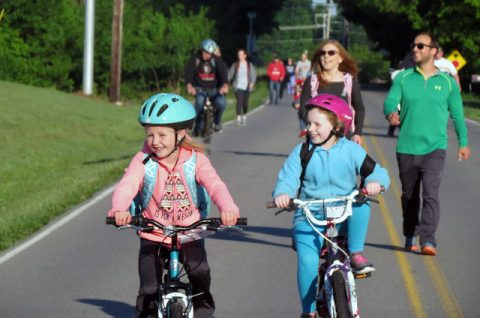 Pisgah Elementary School children ride their bikes to school on National Bike to School Day