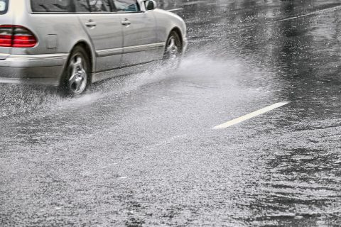 Slowing down during wet weather driving.