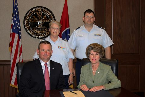(L to R) Montgomery County Mayor Jim Durrett, Diane Gilman, USCG Auxiliary Flotilla Commander, William Welty, USCG Auxiliary Vice Flotilla Commander 082-11-07 Clarksville/Fort Campbell and City of Clarksville Mayor Kim McMillan.
