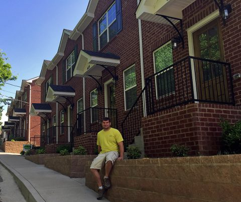 Eric Huneycutt outside completed home at 113 West Washington Street.