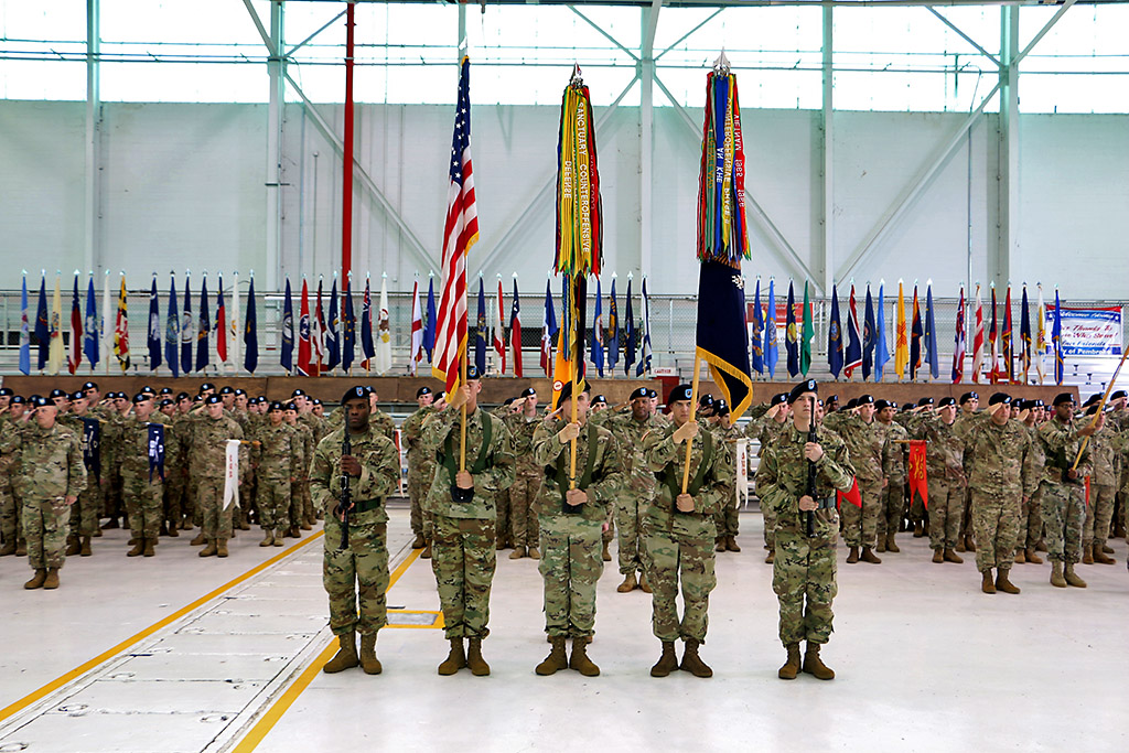 Guidon bearers stand with the American flag and the 2nd Brigade Combat Team, 101st Airborne Division unit colors during a traditional colors of the casing ceremony at 'Hangar 3', Apr. 27, 2016. This the fourth time the unit cases its colors for a deployment to Iraq. (Spc. Andres Alegria, 2nd Brigade Combat Team, 101st Airborne Division (Air Assault))