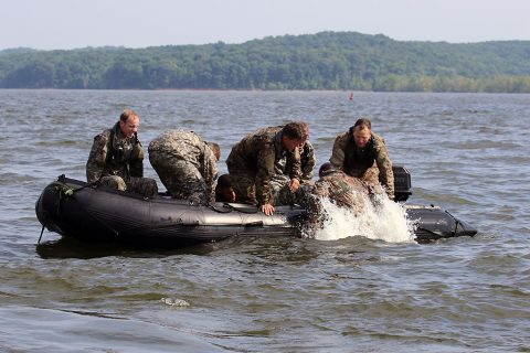 """Soldiers with """"Charlie Rock,"""" C Troop, 1st Squadron Regiment, 32nd Cavalry Regiment, 1st Brigade Combat Team, 101st Airborne Division (Air Assault) pull a Soldier from the water after he jumped from a CH-47 Chinook at Paris Landing State Park May 11, 2016. (Spc. Katie Petrosky, 5th Special Forces Group Public Affairs)"""