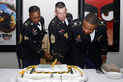 Sgt. Yemaya Webb, Command Sgt. Maj. Michael J. Perry, and Sgt. D'anthony Watkins cut the cake after the NCO Induction Ceremony at Wilson Theater on Fort Campbell, Ky., May 18, 2016. (Sgt. Neysa Canfield, 101st Sustainment Brigade, 101st Airborne Division (AA) Public Affairs)