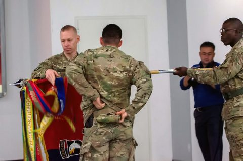 "Col. Brett Sylvia, the commander of 2nd Brigade 101st Airborne Division (Air Assault), ""Task Force Strike,"" and Command Sgt. Maj. Jeremy Gebhardt, the senior noncommissioned officer for 2nd Battalion, 506th Infantry Regiment, 2nd BCT, uncase the Strike Brigade's colors during their transfer of authority ceremony in Erbil, Iraq, May 17th, 2016. (Staff Sgt. Peter Berardi, 205th Press Camp Headquarters)"
