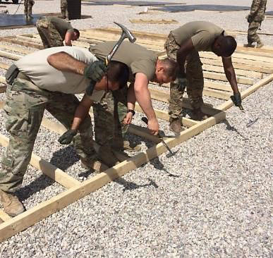 Soldiers in Task Force Strike lay down flooring for a tent April 29, 2016, at Life Support Area Strike in Erbil, Iraq. Task Force Strike is in Iraq as part of Combined Joint Forces Land Component Command – Operation Inherent Resolve, building partner capacity and advising and assisting Iraqi Security Forces. (1st Lt. Kalapu Fasavalu)