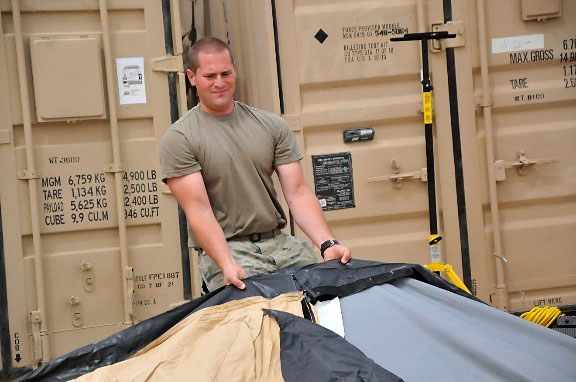 Pfc. Mark Herron, a Soldier in Headquarters and Headquarters Company, 39th Brigade Engineer Battalion, Task Force Strike, helps set up a tent May 18, 2016, at Life Support Area Strike in Erbil, Iraq. Task Force Strike, comprised of Soldiers from the 2nd Brigade Combat Team, 101st Airborne Division (Air Assault), is in Iraq as part of Combined Joint Forces Land Component Command – Operation Inherent Resolve, building partner capacity and advising and assisting Iraqi Security Forces. (1st Lt. Daniel Johnson)