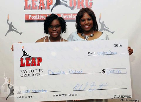 Danielle Dillard and her mom with Scholarship check