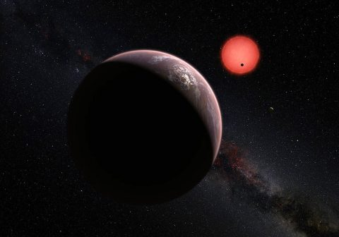 This artist's impression shows an imagined view of the three planets orbiting an ultra-cool dwarf star just 40 light-years from Earth that were discovered using the TRAPPIST telescope at ESO's La Silla Observatory. In this view, one of the inner planets is seen in transit across the disc of its tiny and dim parent star. (ESO/M. Kornmesser/N. Risinger (skysurvey.org))