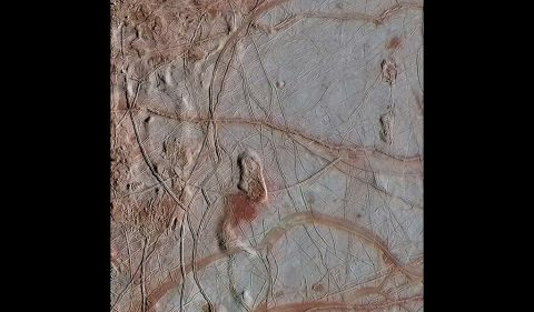This enhanced-color view from NASA's Galileo spacecraft shows an intricate pattern of linear fractures on the icy surface of Jupiter's moon Europa. (NASA/JPL-Caltech/ SETI Institute)