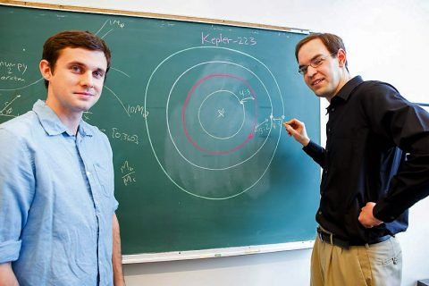 Sean Mills (left) and Daniel Fabrycky (right), researchers at the University of Chicago, describe the complex orbital structure of the Kepler-223 system in a new study. (Nancy Wong/University of Chicago)